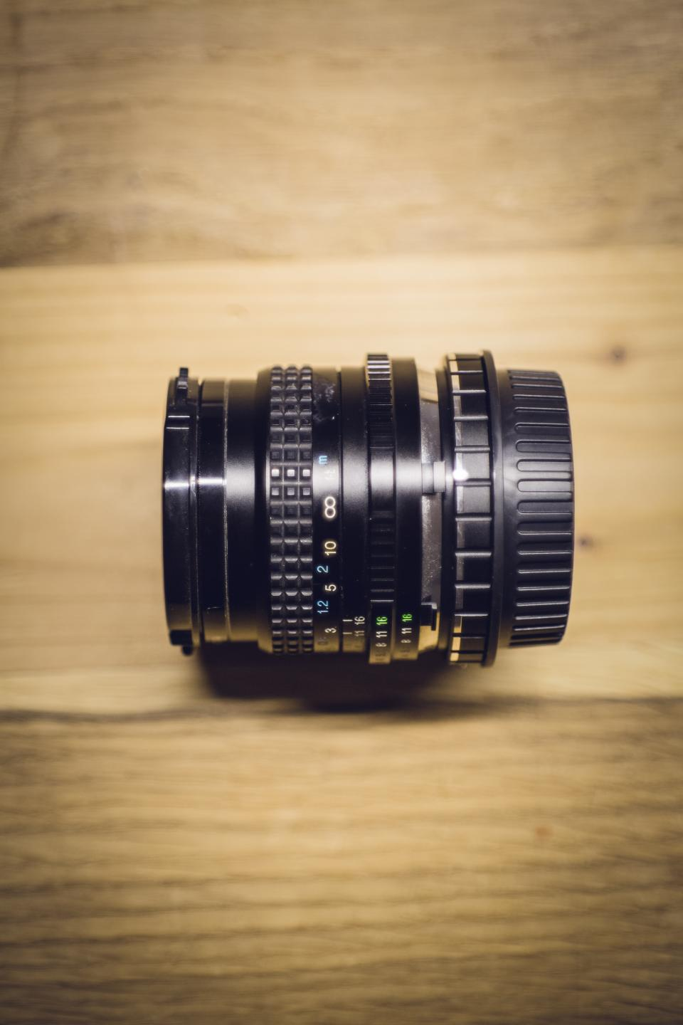 camera lens black photography blur table