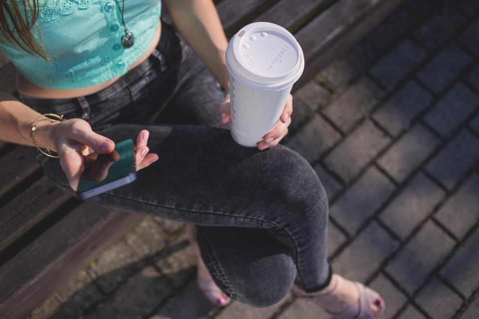 girl texting mobile smartphone woman people coffee cup drink park bench