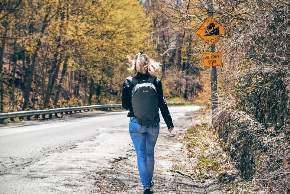 people woman travel adventure road trees woods forest walk alone