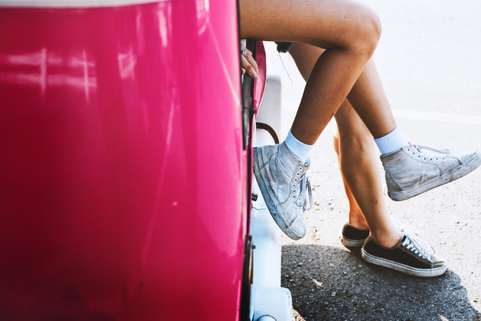 car couple enjoyment feet joyful legs outdoors pair rest road road trip shoes stop transportation travel trip two van vehicle wanderlust woman women