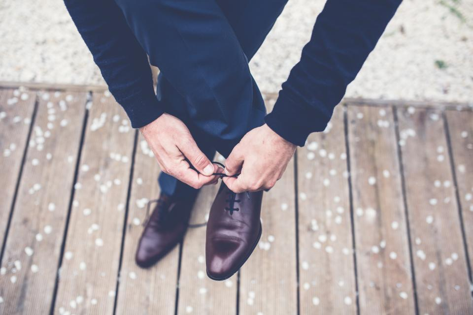 suit tuxedo wedding groom shoes laces hands celebration