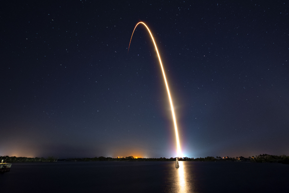 rocket space night launch liftoff trail stars sky technology science travel cosmos outdoors spaceship spacex