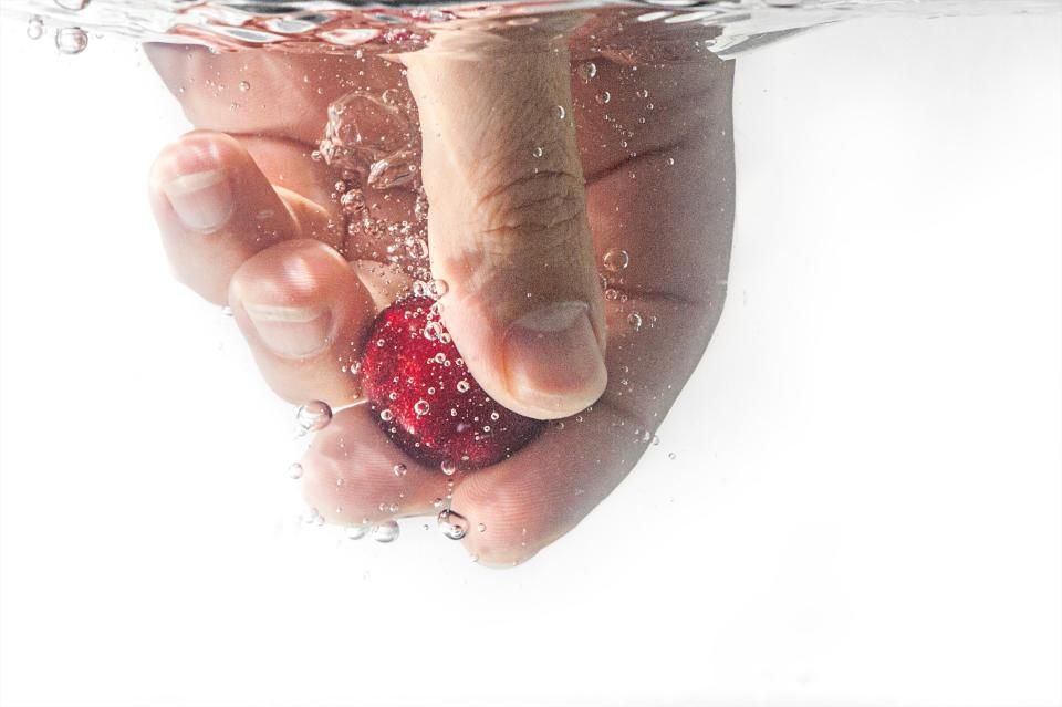 people hand water bubbles nail red fruit
