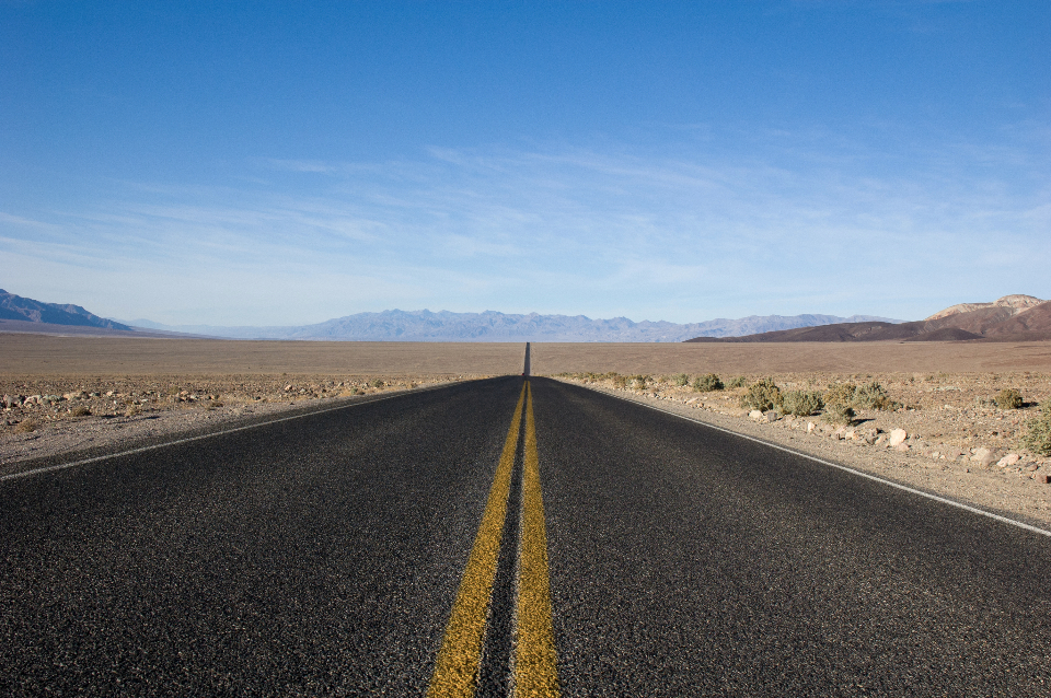 highway road pavement desert dirt landscape nature outdoors mountains blue sky sunshine death valley california road