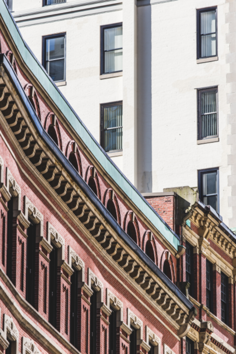 ornate facade building brick exterior windows design architecture wall apartment business city classic structure old