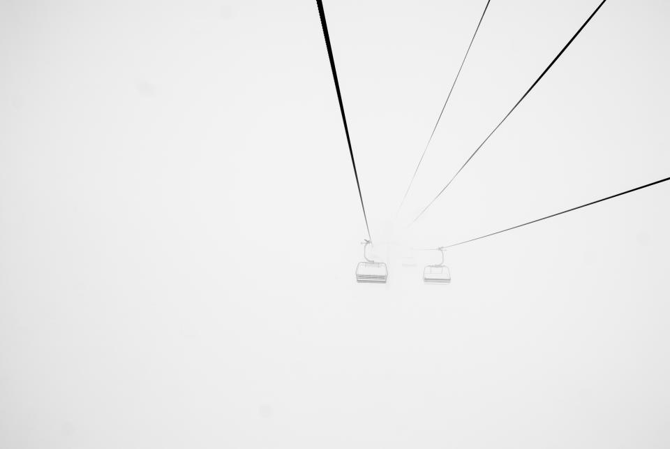 chairlift ski skiing winter snow foggy fog blizzard cold grey cables
