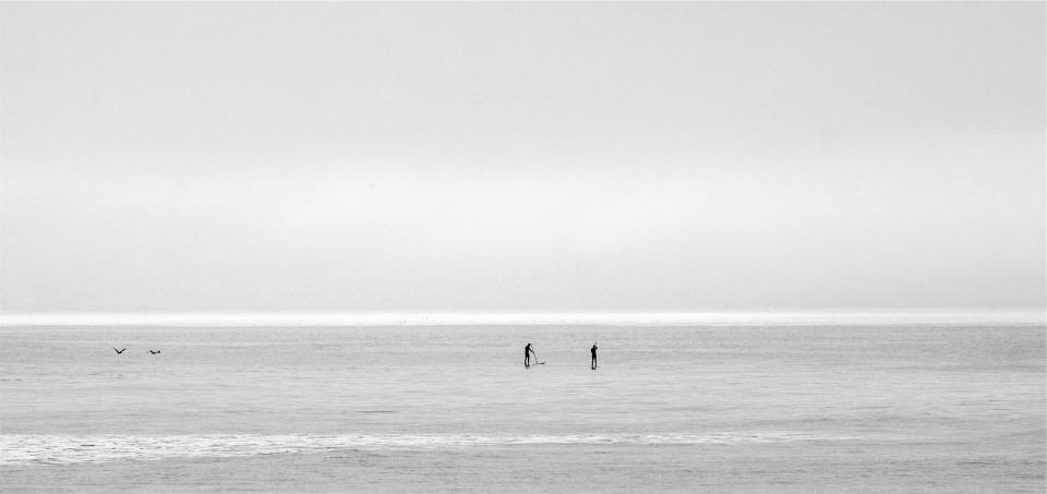 ocean sea horizon sky paddle boarding black and white