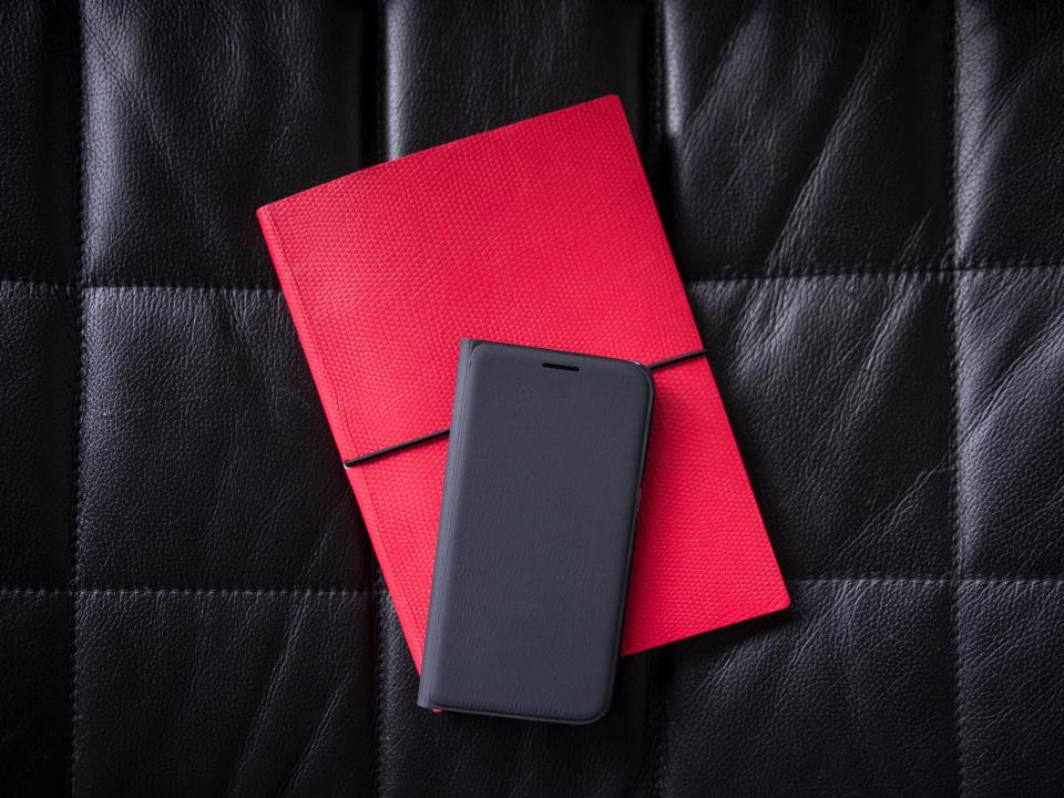 black leather phone case notebook red diary letter technology business
