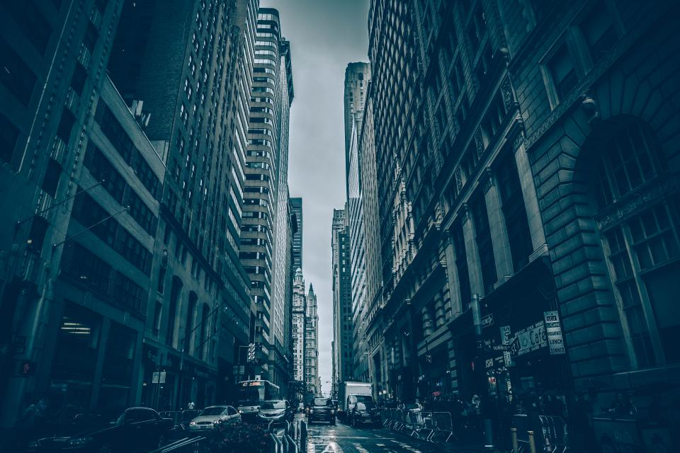 New York city buildings architecture streets roads cars traffic people pedestrians cloudy downtown NYC urban
