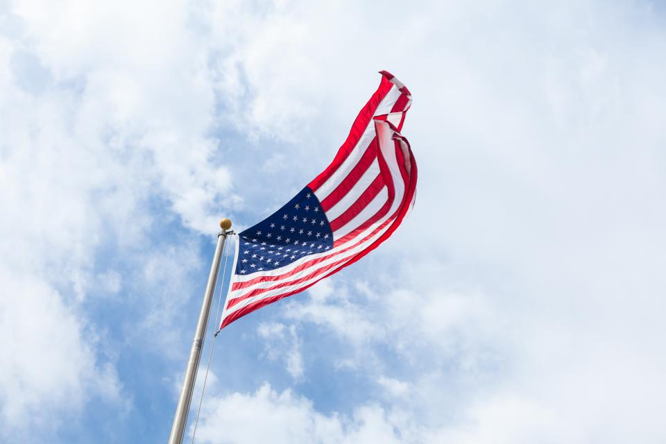 flag united states us clouds sky freedom democracy flag pole