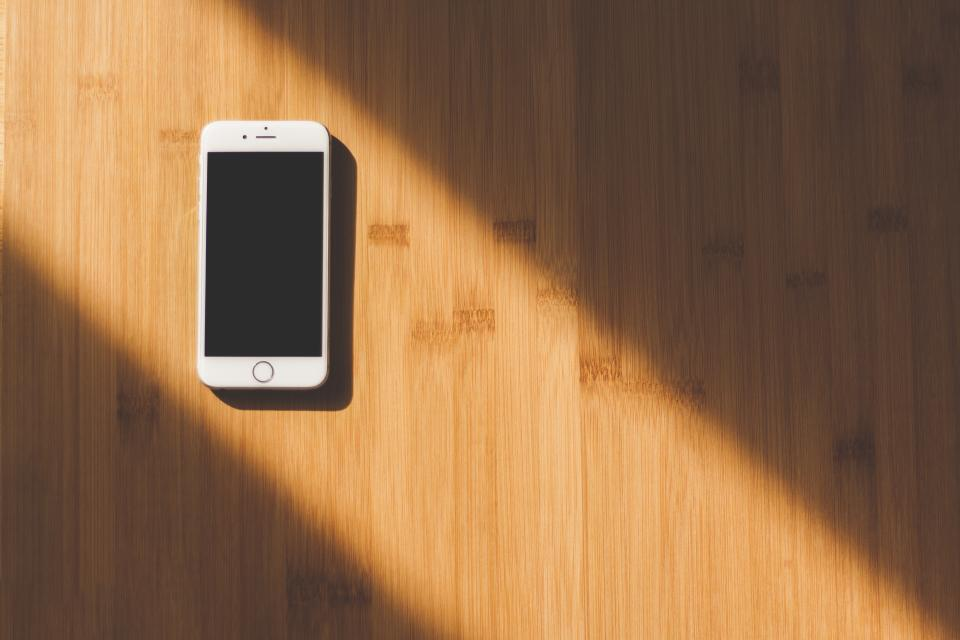 iphone mobile smartphone cell phone technology objects business wood sunlight