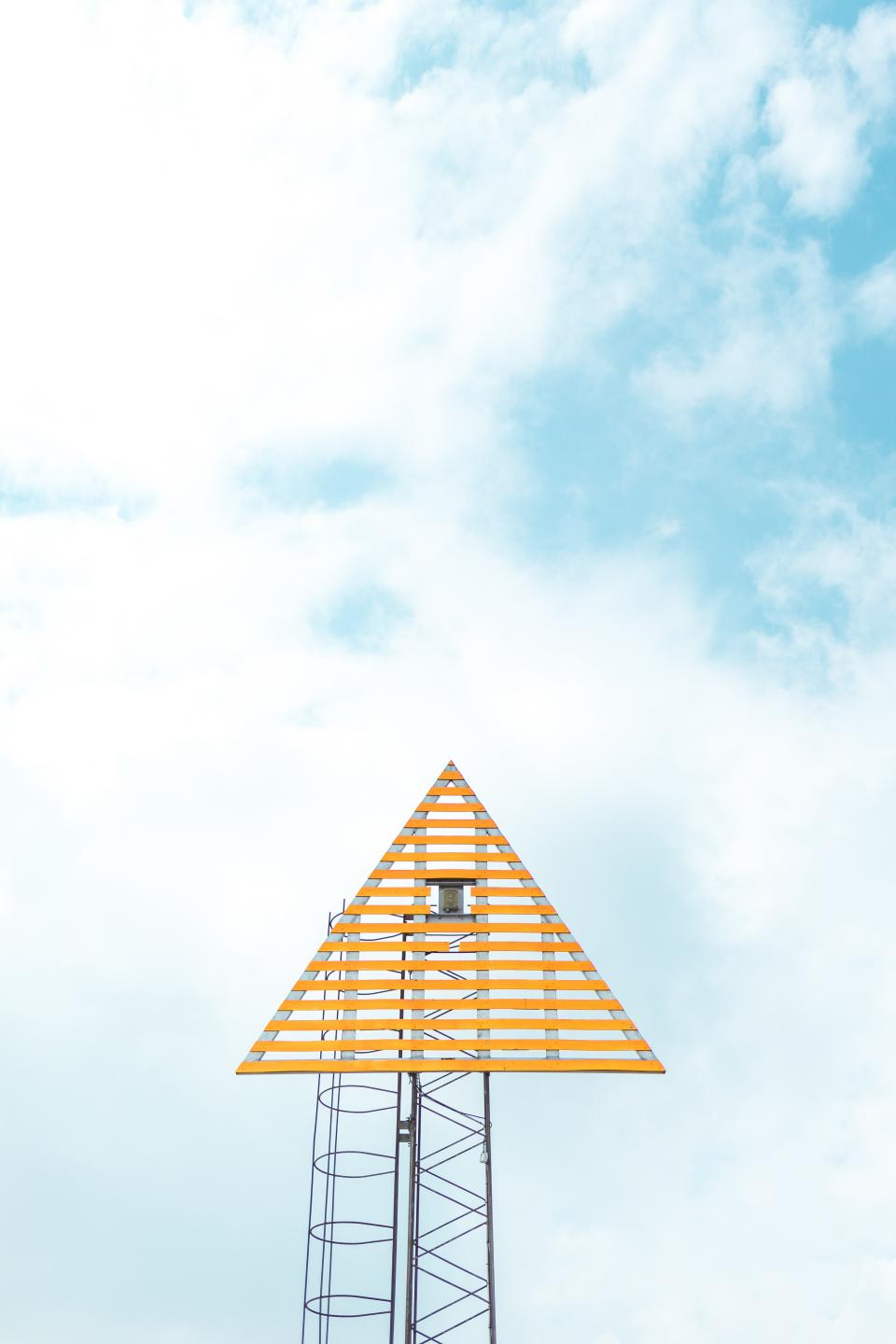 triangular tower camera blue sky cloud