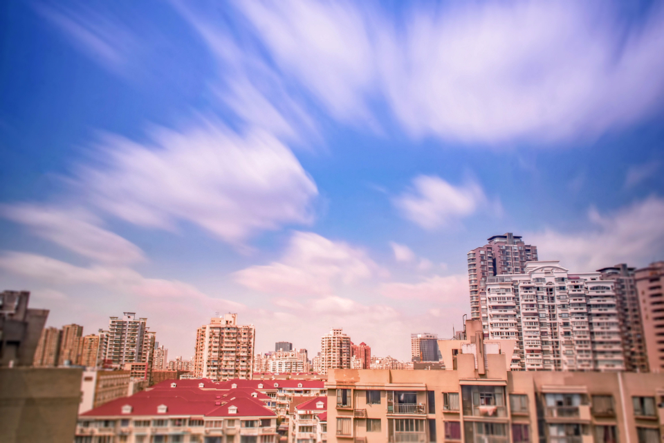 buildings high rises architecture city urban downtown sky clouds cityscape skyline