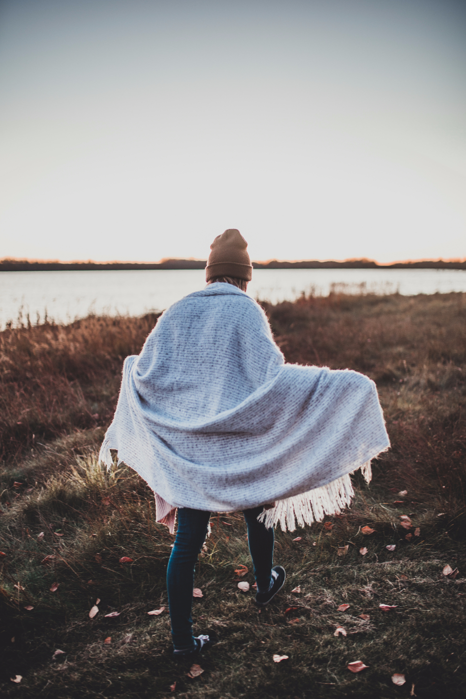 walking girl blonde nature earth female beanie fall cold blanket explore travel lake sky sunset