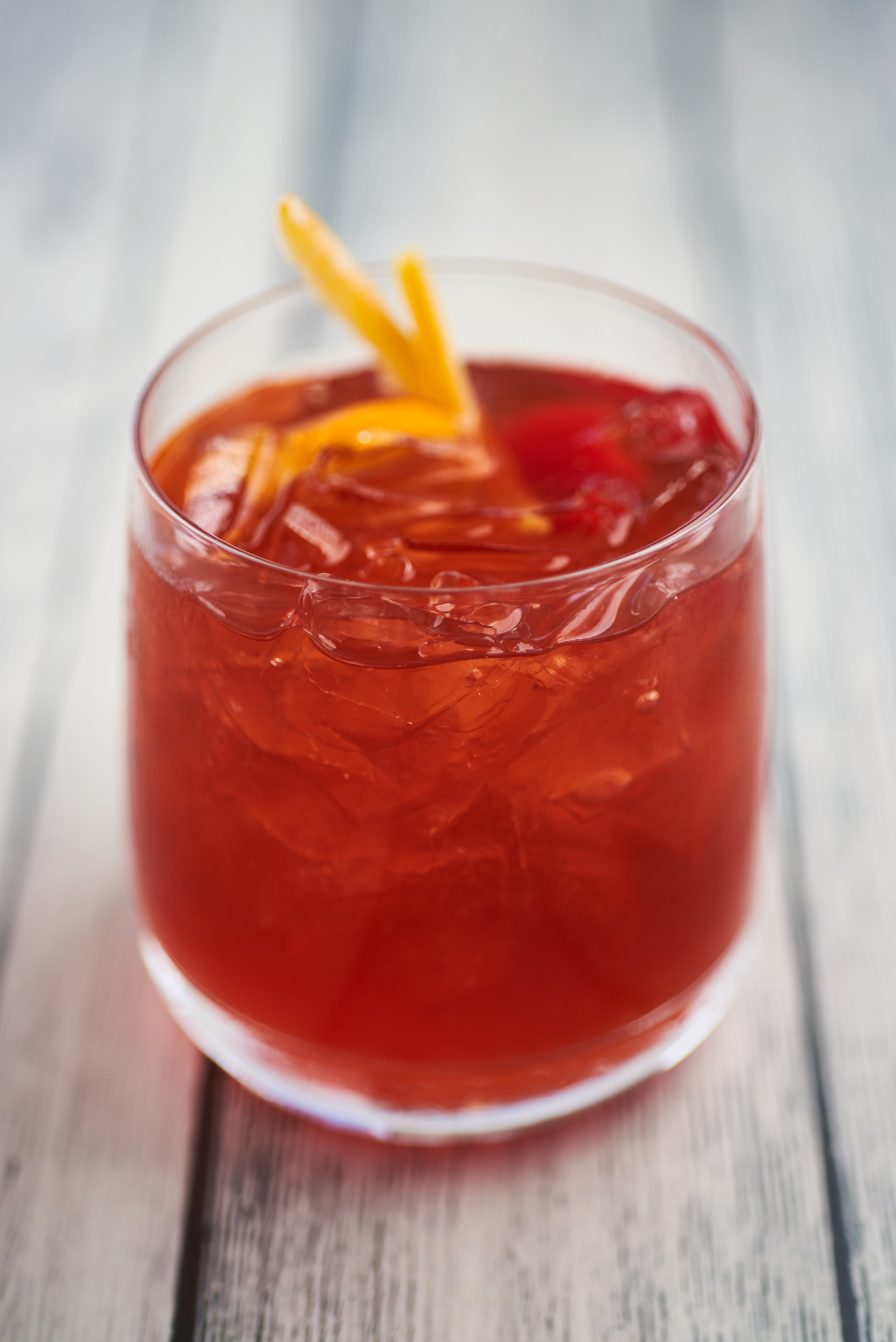 cocktail summer red berry drink beverage alcohol orange garnish fruit glass cold mixed ice wood cherry punch rum