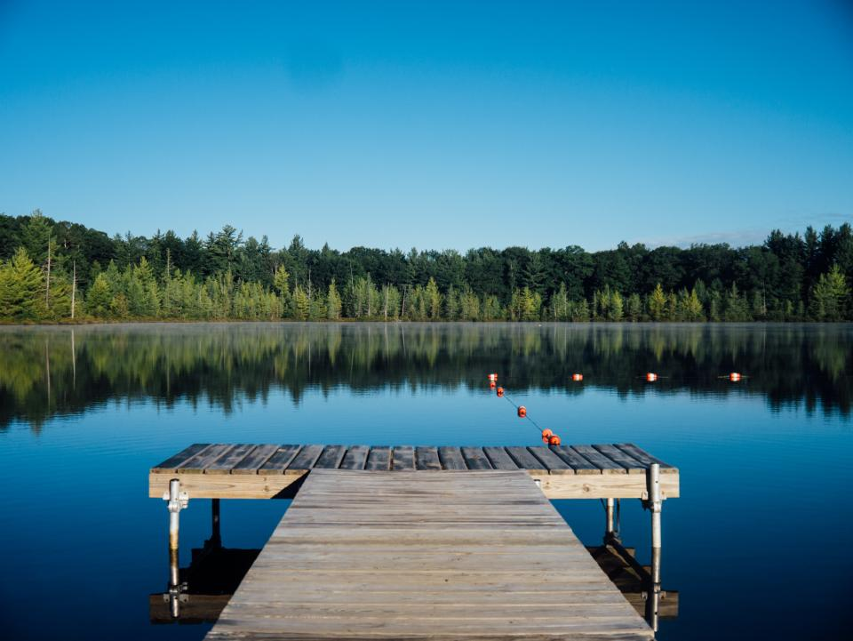 dock lake water reflection trees forest outdoors nature landscape blue sky summer cottage rural countryside