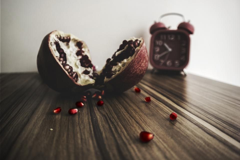 wooden table pomegranate pulp fruit food vitamins blur