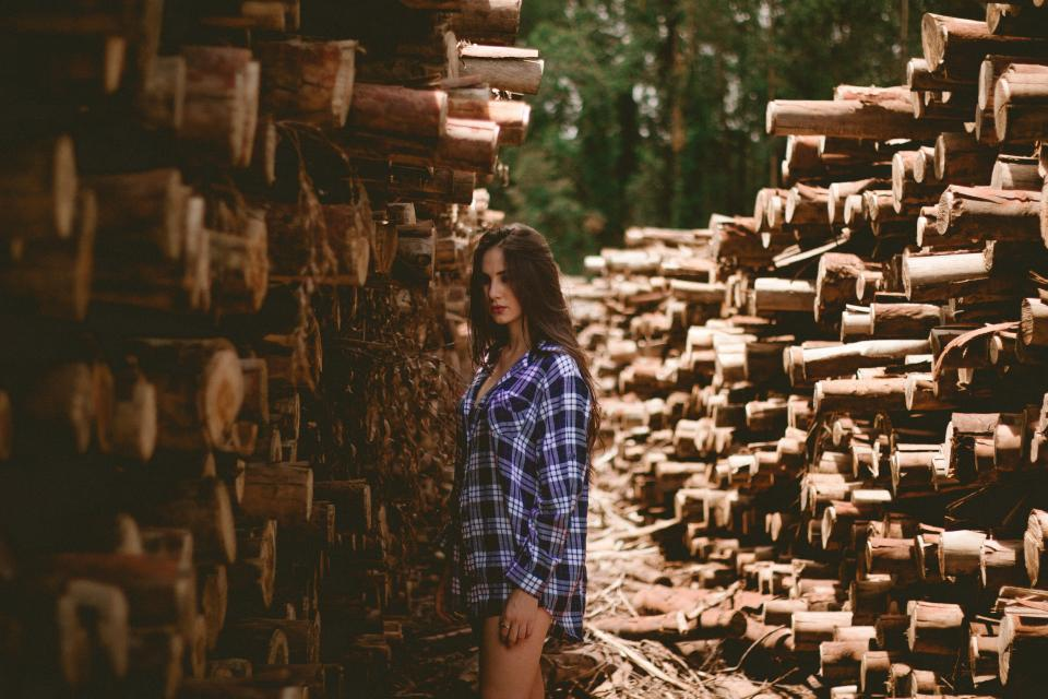 woods woman girl lady model fashion style logs brown trees nature pile branches