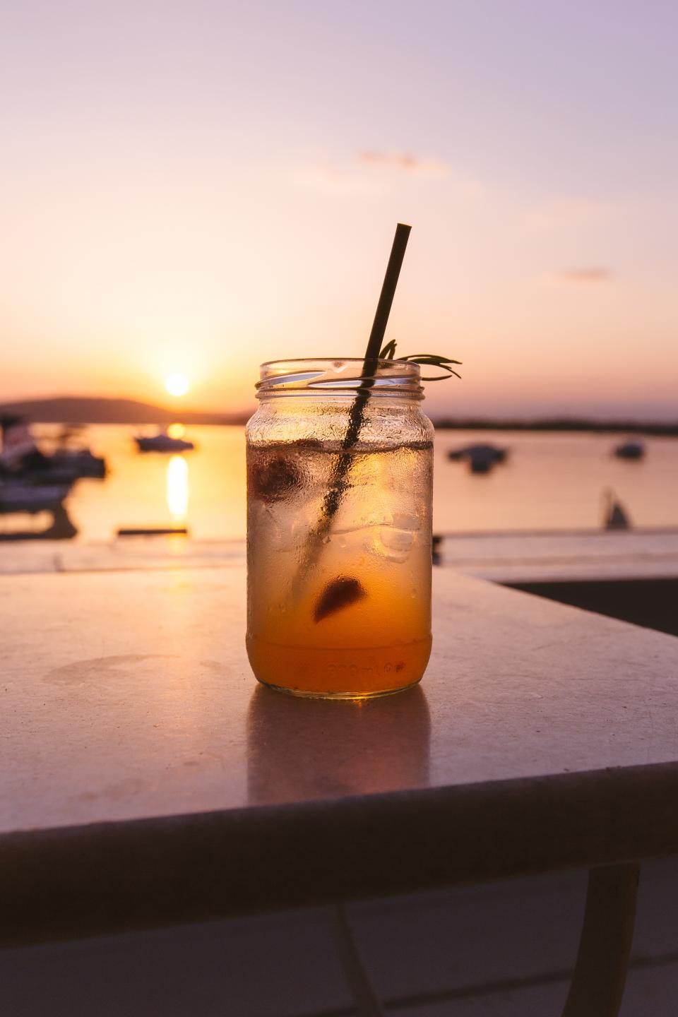 drink cold beverage glass jar straw lemon iced tea sunset sunrise