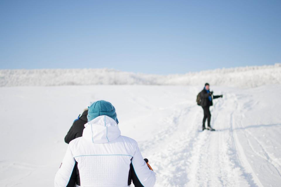 people men outdoor walking hiking snow winter cold weather adventure blue sky travel