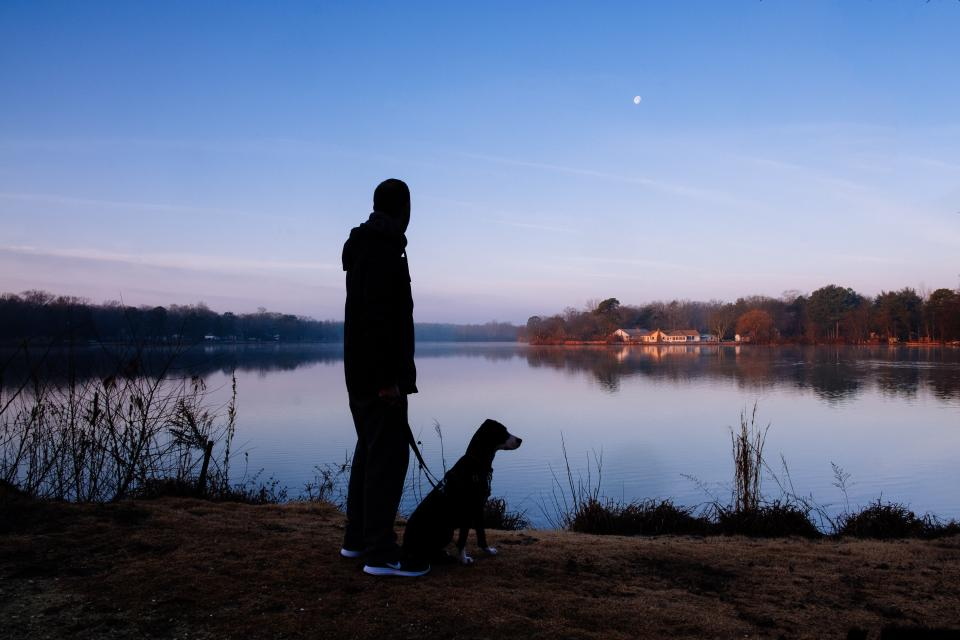 people man silhouette alone dog animal moon clouds sky lake river household trees grass leash