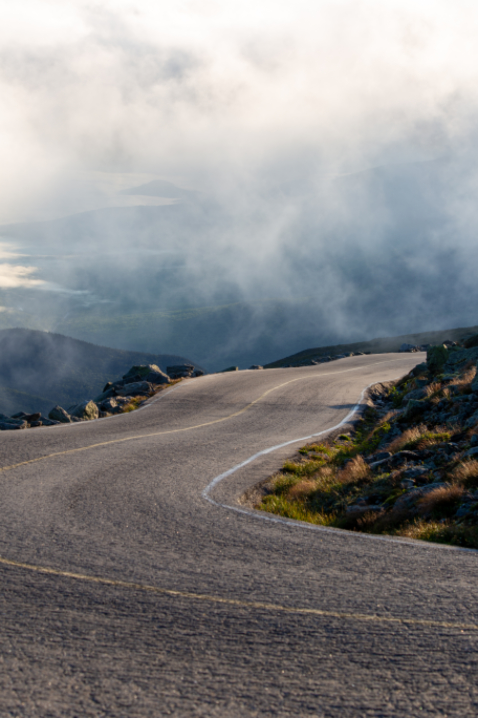 misty mountain road curvy fog clouds sky driving cliffs nature landscape travel route hills