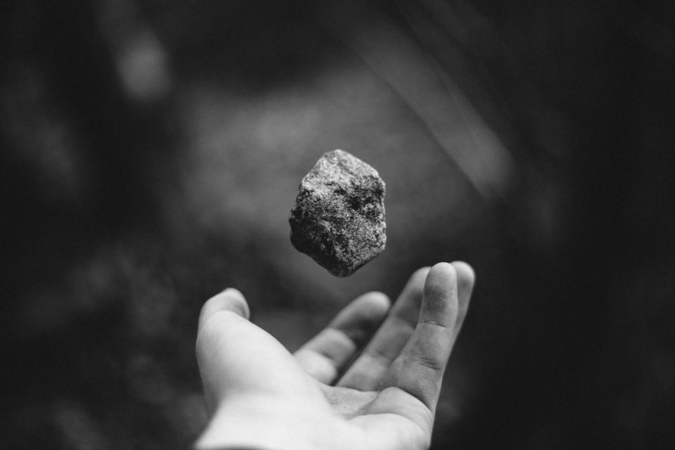 guy man male people hand hold rock levitate float amazing still bokeh black and white