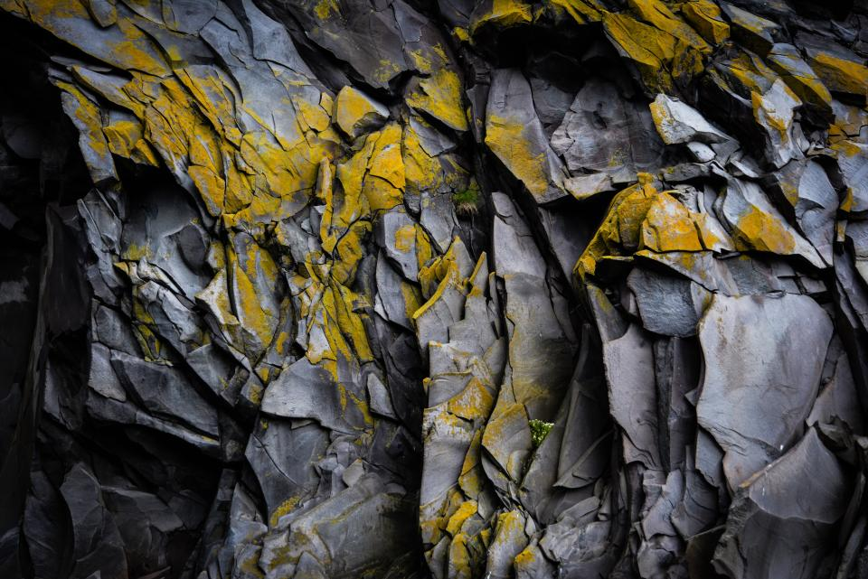 nature cave crevice rocks formation yellow lines striations patterns shapes geometric art