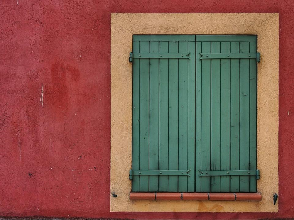 red green shutters window wall