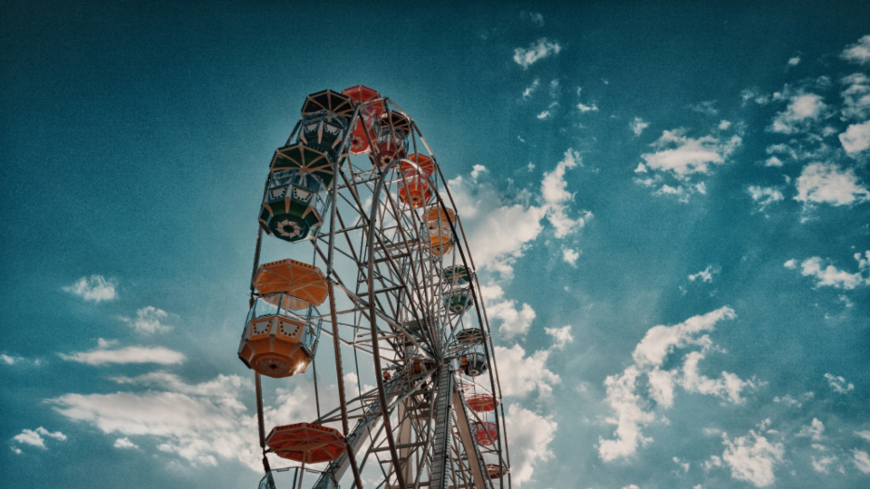 ferris wheel amusement park fun playblue sky clouds festival fairground