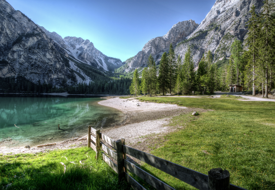 lake mountains lakeside dolomites summer sun water fence landscape blue sky green trees grass outdoors hd wallpaper desktop wallpaper