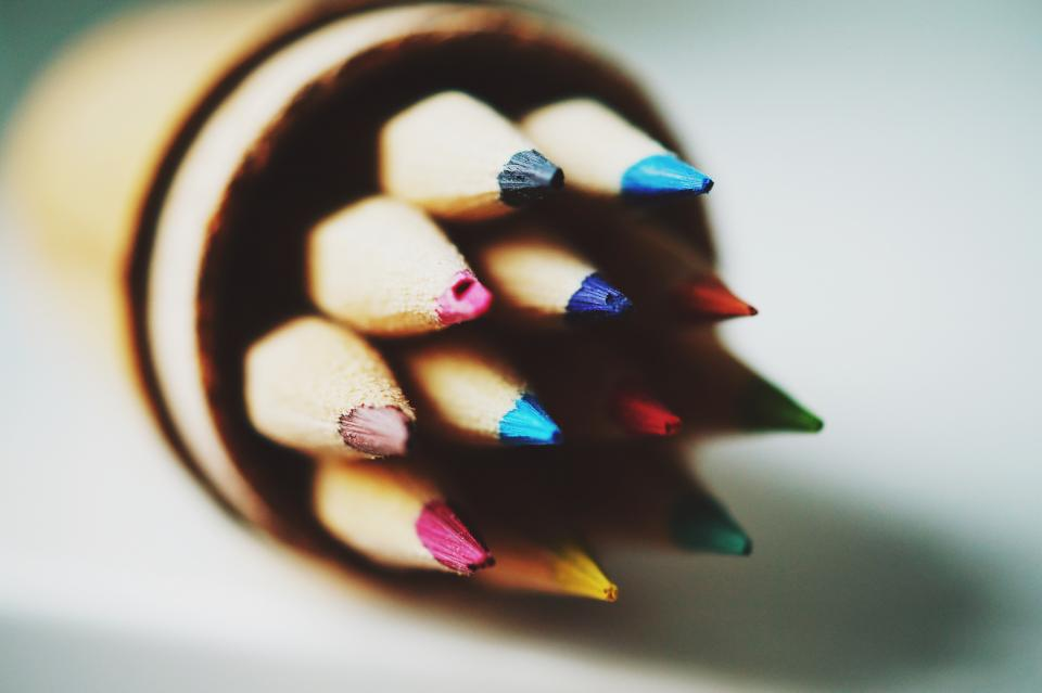 still items things pencils colored sharp canister desk table bokeh