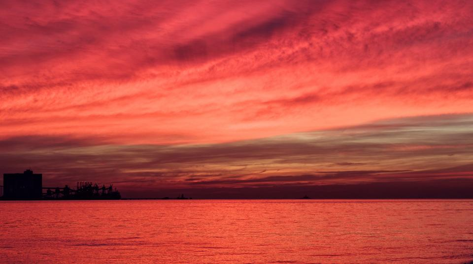 nature landscape water ocean sea still sunset red clouds sky