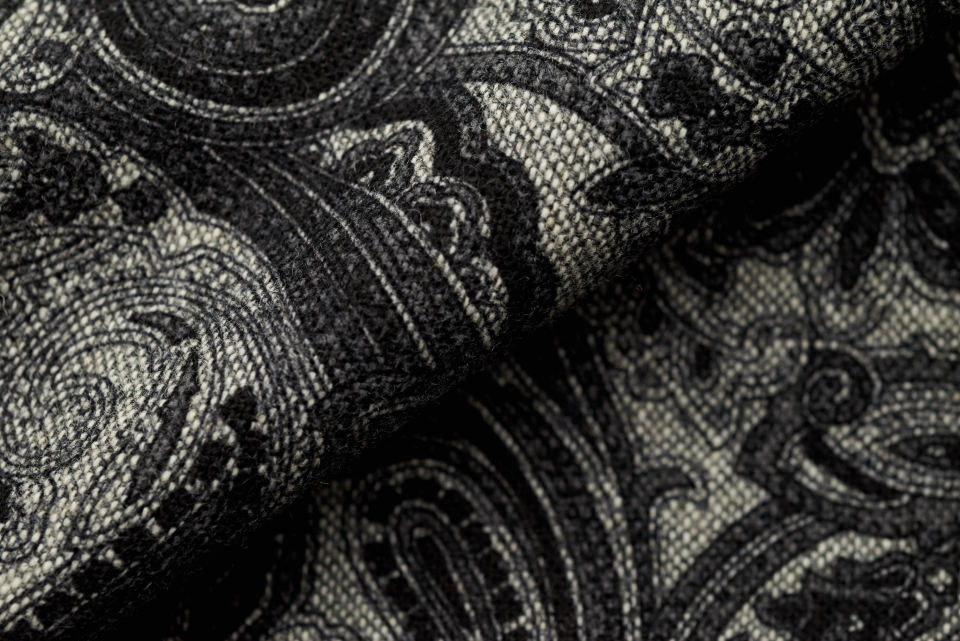 paisley fabric closeup pattern close detail garment fold texture cloth clothing design material woven weave fiber fashion cover textile black gray