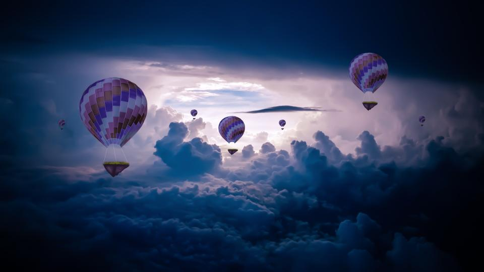 hot air balloon blue sky dark clouds