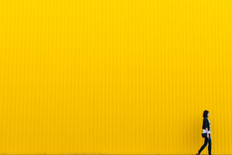 yellow wall building architecture girl woman people