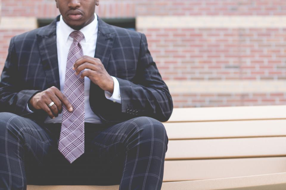 blazer man guy necktie ring african american bricks wall bench chair suit people business male