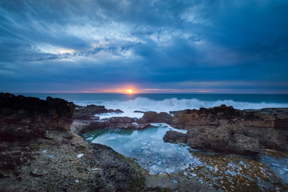 ocean sea waves rocks shore coast dark sunset dusk sky clouds landscape nature