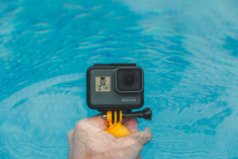 gopro camera photography hand swimming pool water