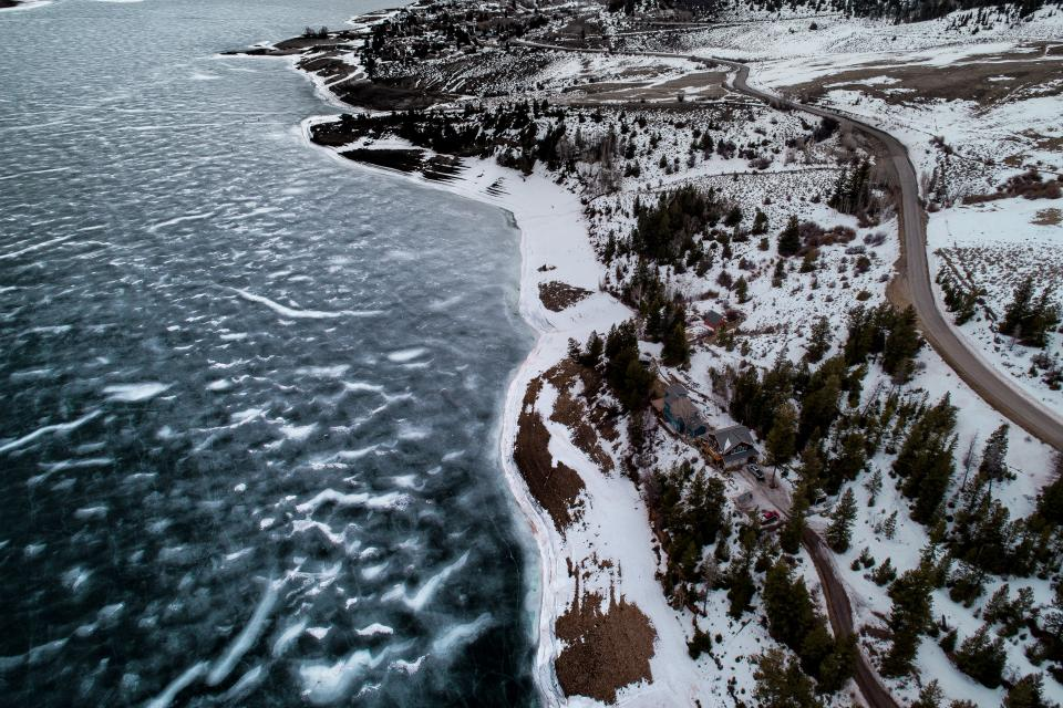 lake water nature snow winter coast aerial road highland landscape trees plant