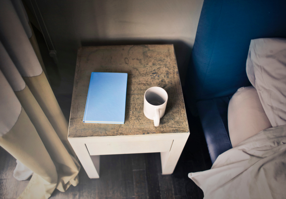 coffee blue notepad bed table hotel room bedroom