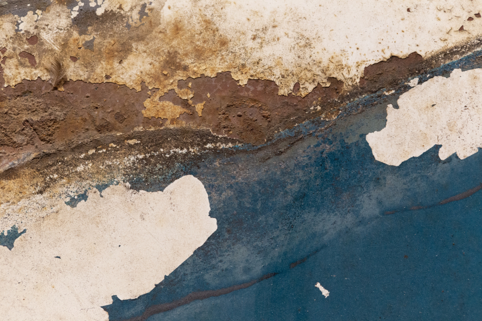 old rusty metal peeling paint distressed aged worn weathered automotive car dirty grunge texture surface close up