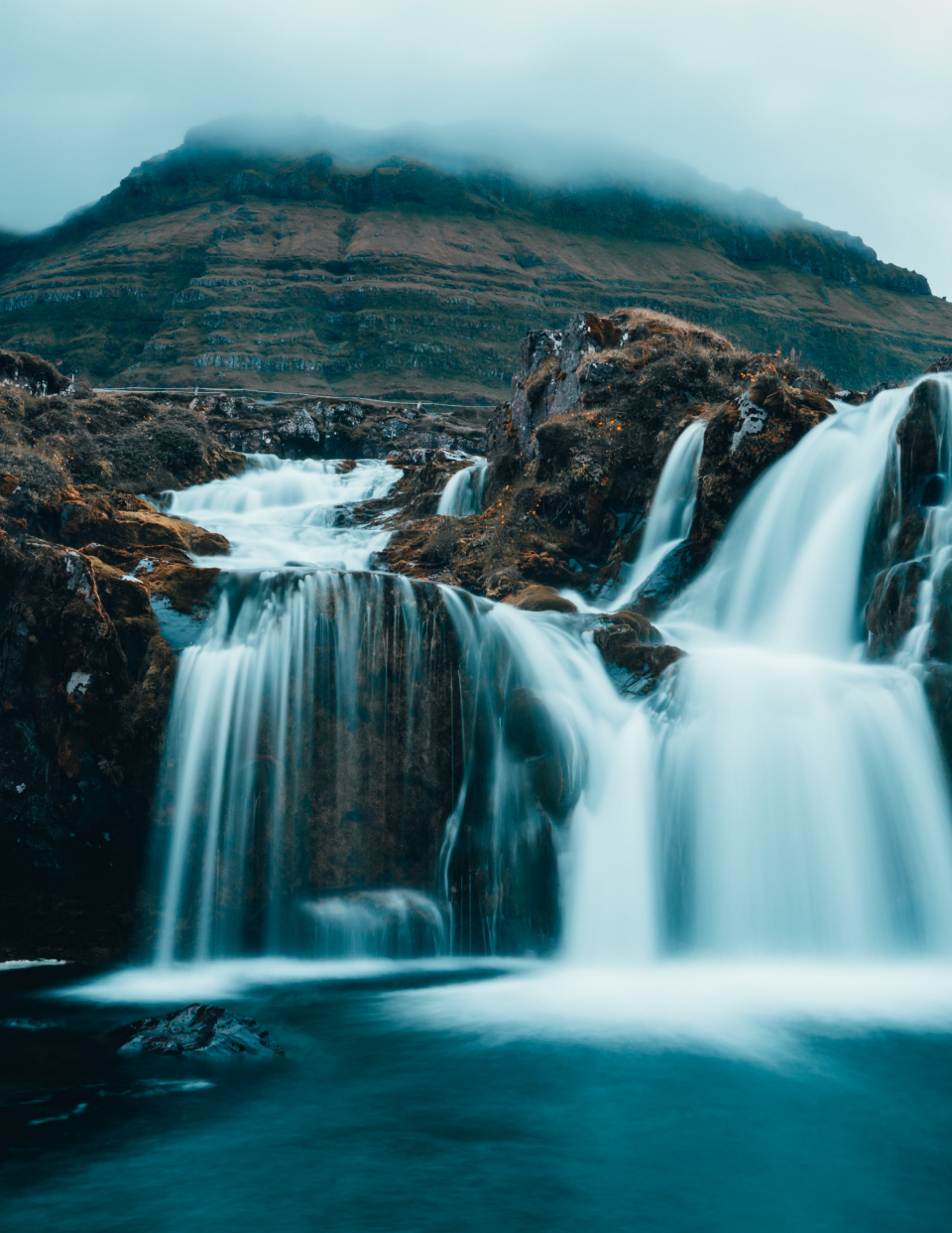 cloudy mountain waterfall rural landscape beautiful nature outdoors moody water long exposure climate weather environment travel explore hiking wanderlust