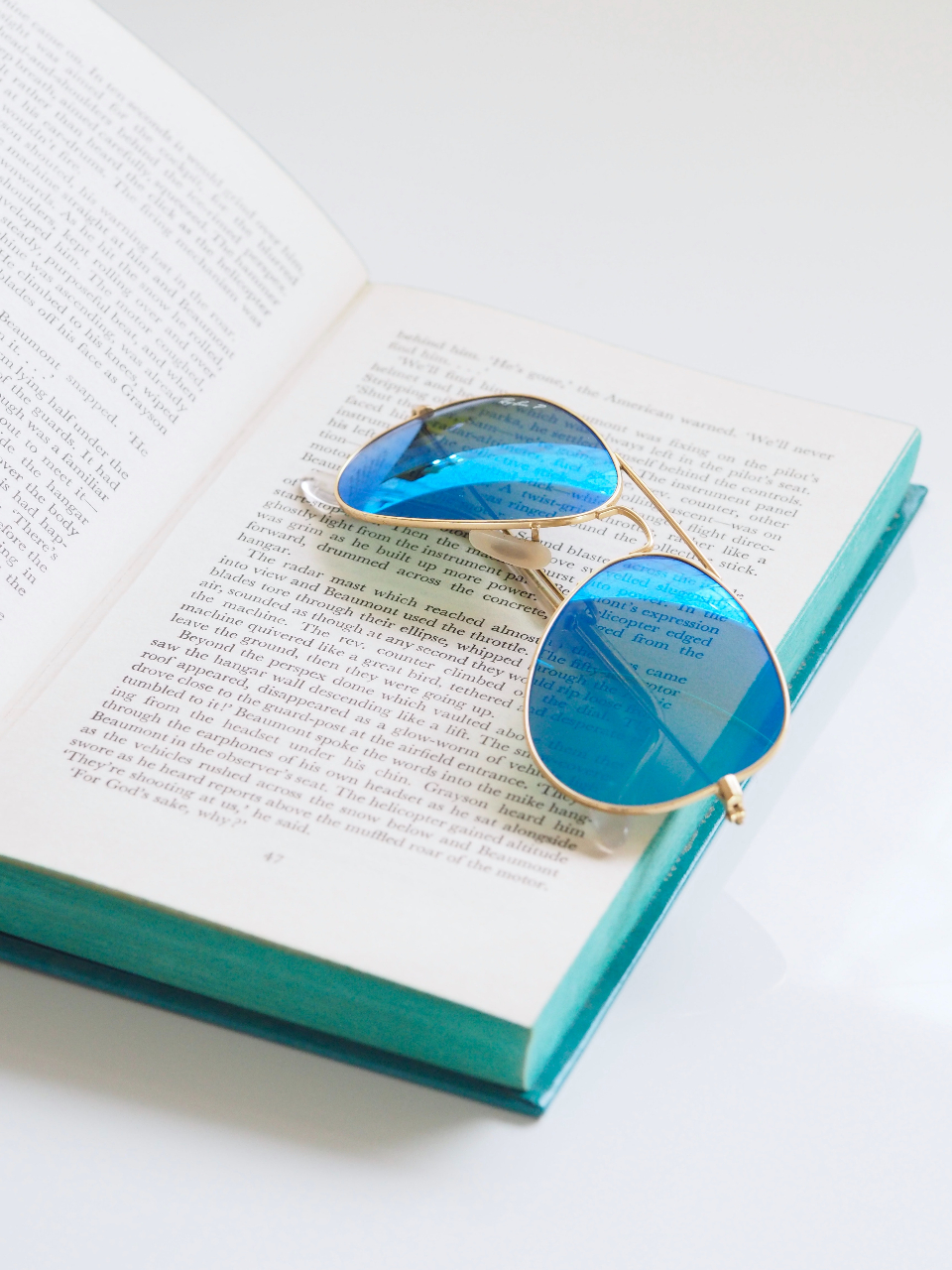 blue sunglasses book open book read write literature white background mobile wallpaper