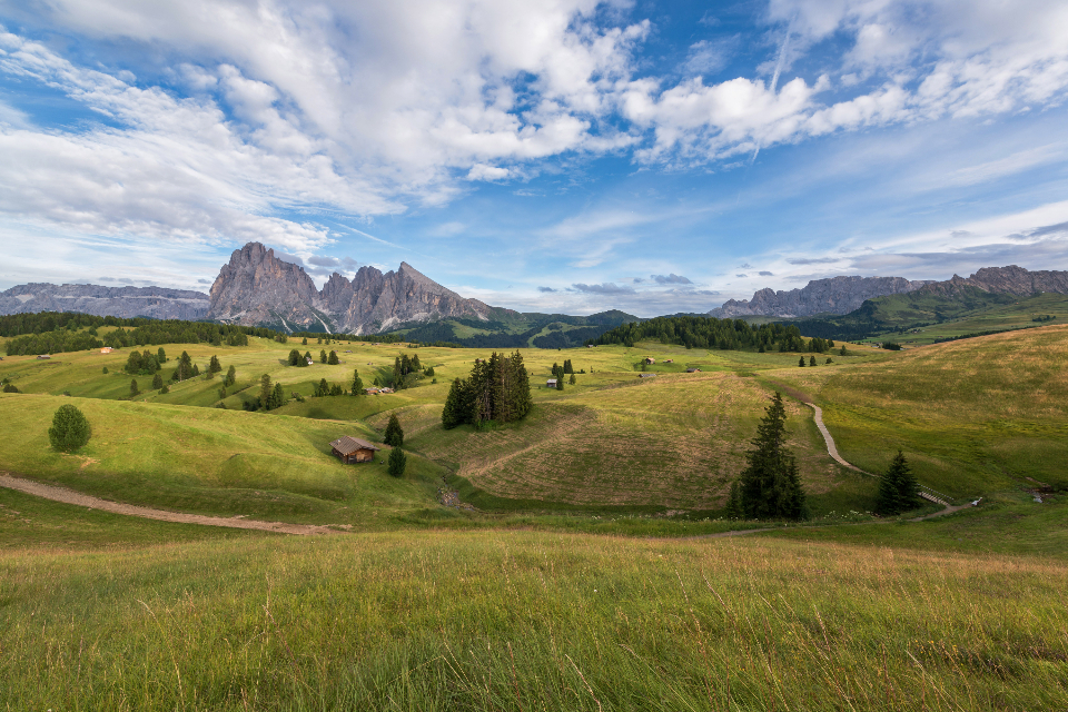 dolomites landscape rock italy hiking alps nature travel valley view val gardena person summer outdoor looking vacation high clouds male path peak trail traveler backpacker italian beautiful edge young people m