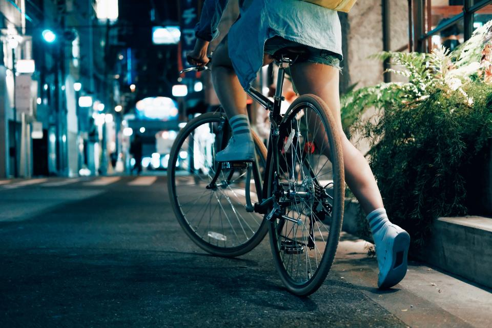 road street people girl riding bike bicycle vehicle night
