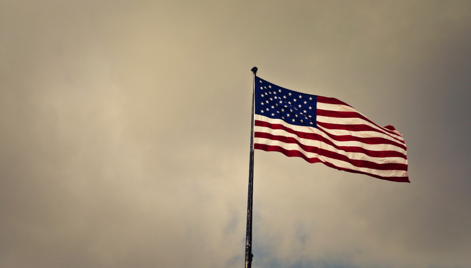 waving american flag star & stripes cloudy sky usa america