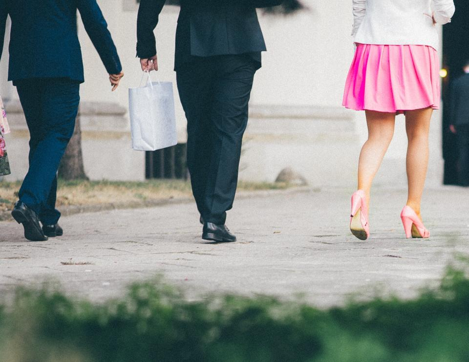 suits shoes high heels pink skirt bags fashion shopping people walking pedestrians path pavement friends group shopping