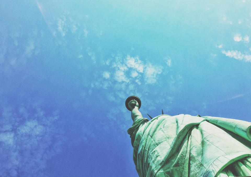 statue of liberty blue sky clouds summer sunshine