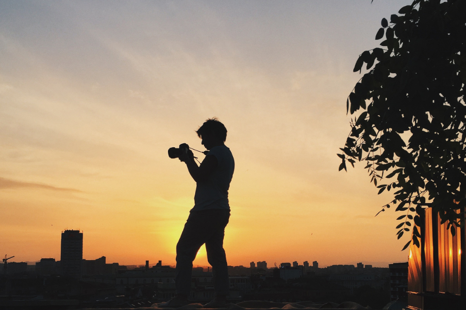 person photographer silhouette camera professional sunset male man taking picture evening sunlight city urban